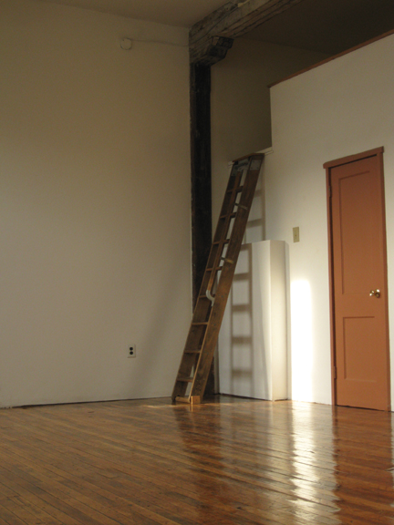 On the right is a laundry room with library ladder to the storage loft above it.